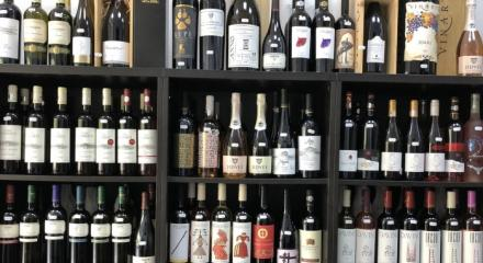 Why is it recommended to buy wine from specialized wine stores?